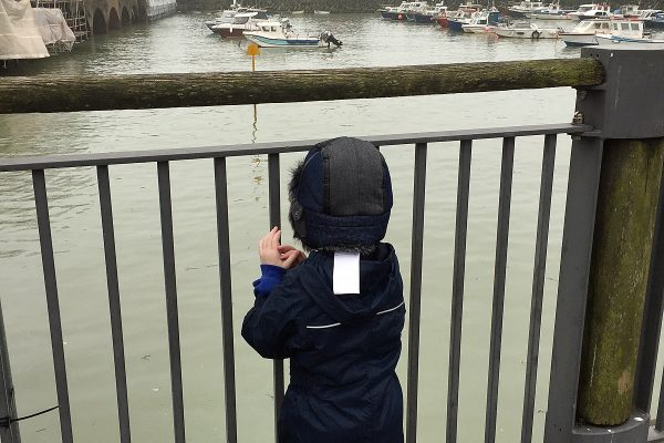 Year R pupil looking at different boats