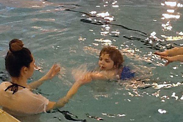 Daiton swimming across the pool
