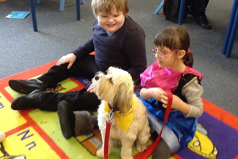 Harvey the dog sits with Leon and Jasmine