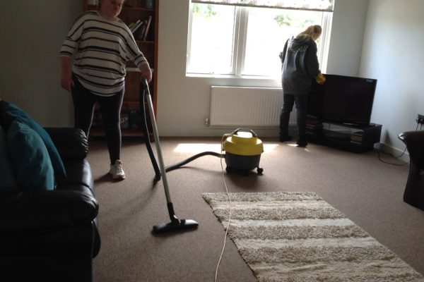 We are hoovering and dusting in the lounge.
